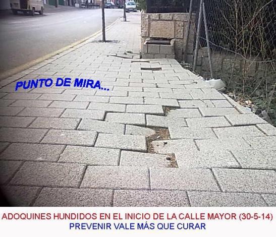 Adoquines hundidos en calle Mayor